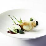 Fagottini ripieni di caprino fresco con insalata di puntarelle